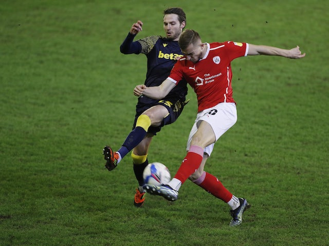 Barnsley's Michal Helik in action with Stoke City's Nick Powell in the Championship on February 24, 2021