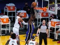 Los Angeles Lakers center Montrezl Harrell dunks the ball against Portland Trail Blazers guard Rodney Hood on February 27, 2021