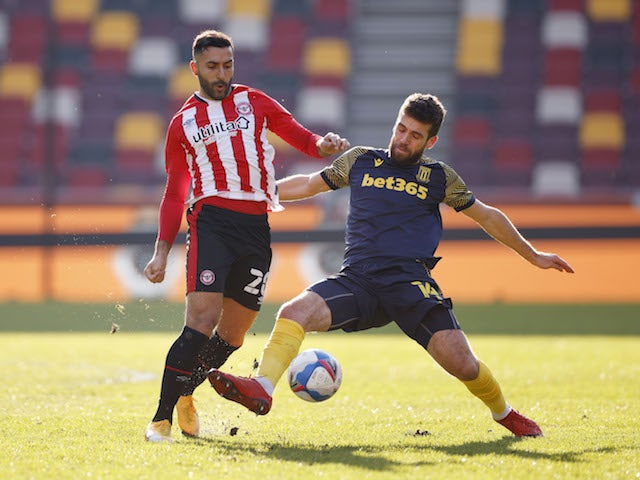 Brentford's Saman Ghoddos in action with Stoke's Tommy Smith on February 27, 2021