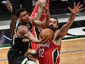 Milwaukee Bucks forward Giannis Antetokounmpo makes a layup against New Orleans Pelicans center Steven Adams on February 26, 2021