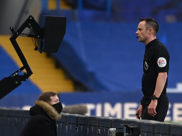 Referee Stuart Attwell looks at the monitor in the Premier League on February 28, 2021