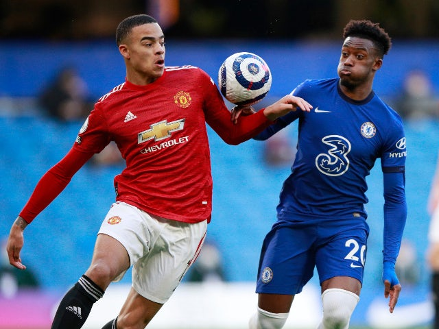Chelsea's Callum Hudson-Odoi appears to handle the ball while in action with Manchester United's Mason Greenwood in the Premier League on February 28, 2021