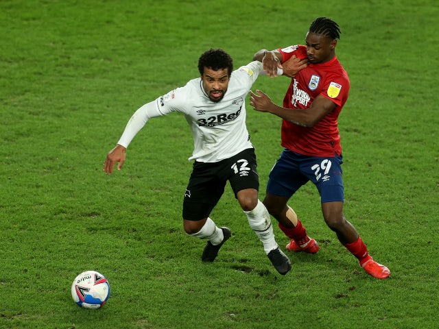 Derby County's Nathan Byrne in action with Huddersfield Town's Aaron Rowe on February 23, 2021
