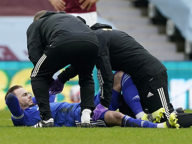 Leicester City's James Maddison receives medical attention after sustaining an injury in February 2021