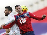 Lille's Sven Botman in action with AS Monaco's Kevin Volland in Ligue 1 on December 6, 2020