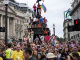 Revellers take over on Piccadilly Circus for London Pride 2019