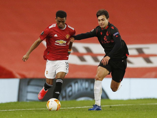 Manchester United's Amad Diallo in action with Real Sociedad's Ander Guevara in the Europa League on February 25, 2021