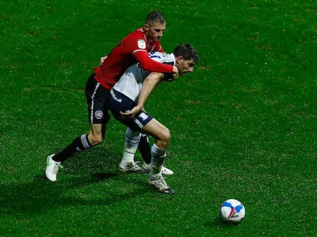 Preston North End's Ched Evans in action with Queens Park Rangers' Dominic Ball in the Championship on February 24, 2021