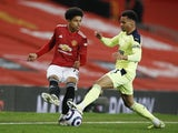 Manchester United's Shola Shoretire in action with Newcastle United's Jacob Murphy in the Premier League on February 21, 2021
