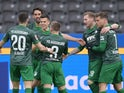 FC Augsburg's Laszlo Benes celebrates scoring their first goal with teammates on March 6, 2021