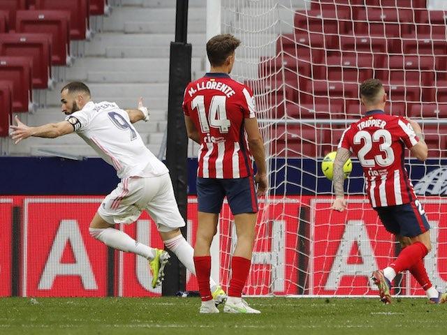 Real Madrid's Karim Benzema celebrates scoring against Atletico Madrid in La Liga on March 7, 2021