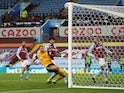 Wolverhampton Wanderers' Romain Saiss misses an open goal against Aston Villa in the Premier League on March 6, 2021
