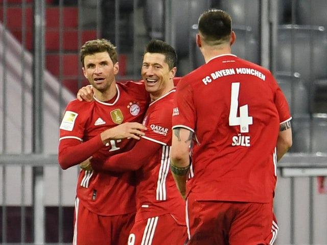 Robert Lewandowski celebrates scoring for Bayern Munich against Borussia Dortmund in the Bundesliga on March 6, 2021