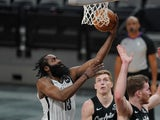 Brooklyn Nets guard James Harden shoots in the second half against the San Antonio Spurs on March 2, 2014
