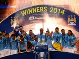 Manchester City celebrate winning the EFL Cup in March 2014