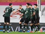 Tottenham Hotspur players celebrate Fulham's own goal during their Premier League clash on March 4, 2021