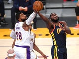 Los Angeles Lakers forward Markieff Morris defends a shot by Golden State Warriors forward Eric Paschall on March 1, 2021