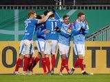 Holstein Kiel's Janni Serra celebrates scoring their first goal with teammates in February 2021