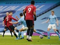 Manchester United's Luke Shaw scores against Manchester City in the Premier League on March 7, 2021