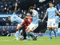 Manchester City's Gabriel Jesus fouls Manchester United's Anthony Martial in the Premier League on March 7, 2021
