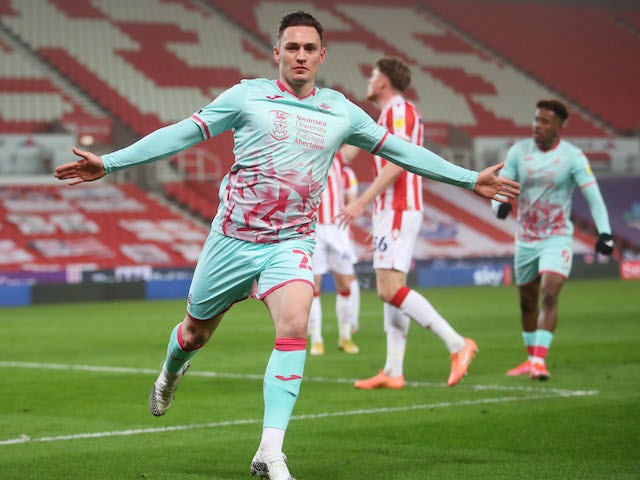 Swansea City's Connor Roberts celebrates scoring against Stoke City in the Championship on March 3, 2021