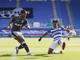 Sheffield Wednesday's Osaze Urhoghide in action with Reading's Omar Richards on March 6, 2021
