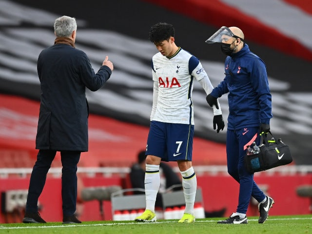 Tottenham Hotspur's Son Heung-min goes off injured against Arsenal in the Premier League on March 14, 2021
