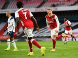 Martin Odegaard celebrates scoring for Arsenal against Tottenham Hotspur in the Premier League on March 14, 2021