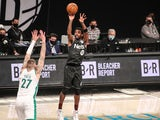 Brooklyn Nets guard Kyrie Irving (11) shoots a three point shot in the third quarter against the Boston Celtics on March 12, 2021