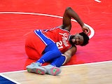 Philadelphia 76ers center Joel Embiid reacts after suffering an apparent leg injury against the Washington Wizards on March 13, 2021