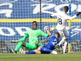 Chelsea's Edouard Mendy makes a save from Leeds United's Raphinha in the Premier League on March 13, 2021