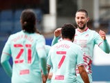 Swansea City's Conor Hourihane celebrates scoring their first goal against Luton Town in the Championship on March 13, 2021