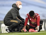 Manchester United forward Marcus Rashford gets treatment for an injury on March 7, 2021
