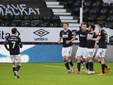 Millwall's Shaun Hutchinson celebrates after scoring their first goal on March 13, 2021
