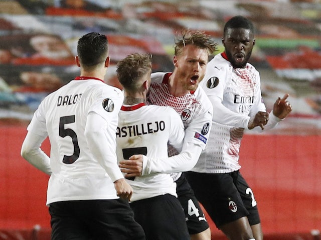 AC Milan's Simon Kjaer celebrates scoring against Manchester United in the Europa League on March 11, 2021