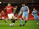 Manchester United's Scott McTominay in action with West Ham United's Declan Rice in the Premier League on March 14, 2021