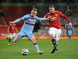 West Ham United's Jarrod Bowen in action with Manchester United's Luke Shaw in the Premier League on March 14, 2021