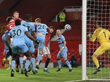 West Ham United's Craig Dawson scores an own goal against Manchester United in the Premier League on March 14, 2021