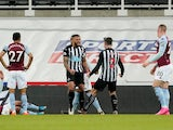 Jamaal Lascelles celebrates scoring for Newcastle United against Aston Villa in the Premier League on March 12, 2021