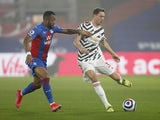 Manchester United's Nemanja Matic in action with Crystal Palace's Jordan Ayew in the Premier League on March 3, 2021