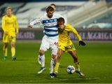 Queens Park Rangers' Charlie Austin in action with Wycombe Wanderers' Curtis Thompson in the Championship on March 9, 2021