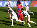 Real Madrid's Karim Benzema celebrates scoring their first goal with teammates on March 13, 2021