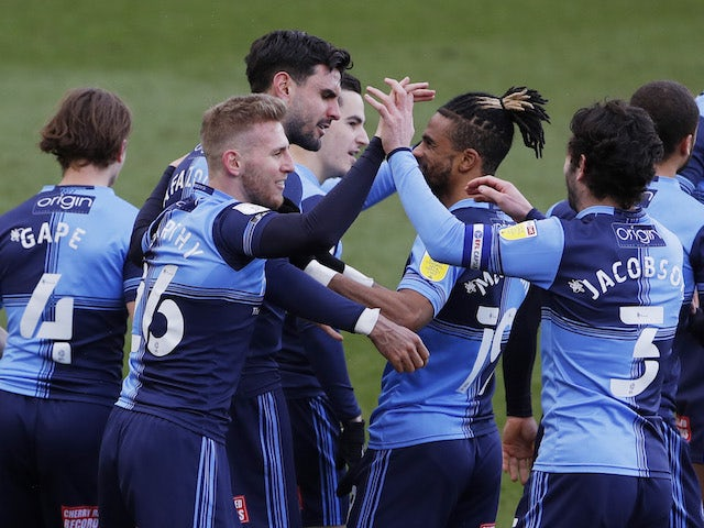 Wycombe Wanderers' Ryan Tafazolli celebrates scoring their first goal with teammates on March 13, 2021