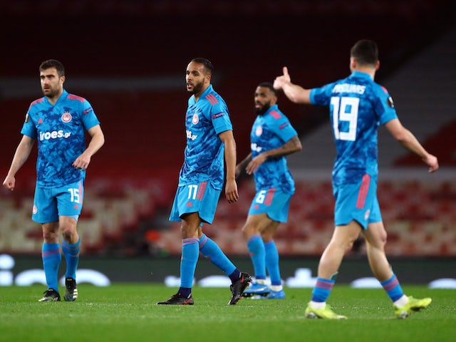 Olympiacos' Youssef El-Arabi celebrates scoring against Arsenal in the Europa League on March 18, 2021