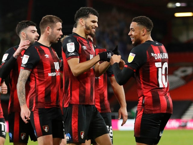Bournemouth's Dominic Solanke celebrates with teammates after Swansea City's Joel Latibeaudiere scored an own goal in the Championship on March 16, 2021