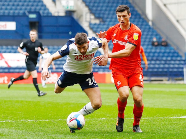 Luton Town's Matty Pearson in action with Preston North End's Ched Evans on March 20, 2021