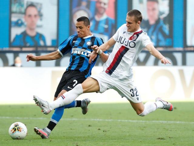 Bologna midfielder Mattias Svanberg tackling Inter Milan forward Alexis Sanchez in July 2020.