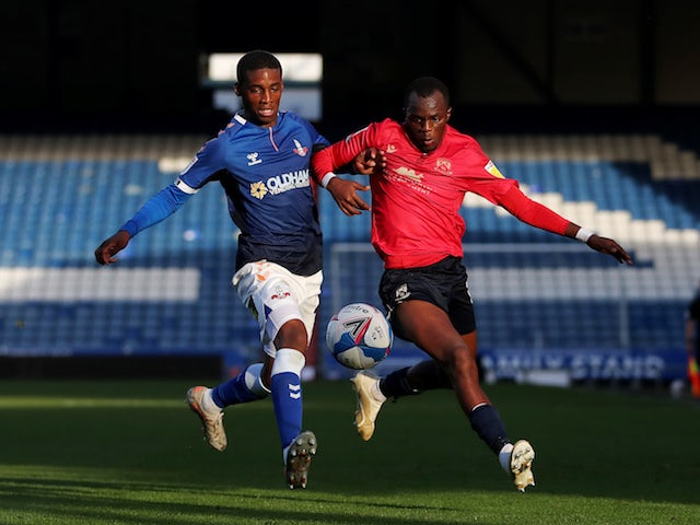 Morecambe's Carlos Mendes Gomes in action with Oldham Athletic's Dylan Fage in League Two on October 20, 2020