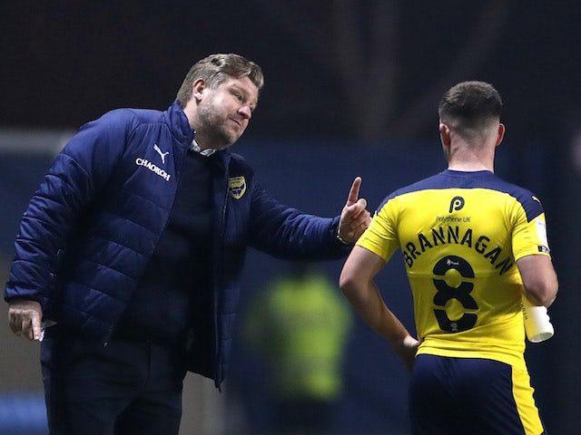 Oxford United's manager Karl Robinson pictured with Cameron Brannagan on March 2, 2021