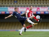 Southend United's Jason Demetriou in action with Exeter City's Jake Taylor in League Two on October 10, 2020